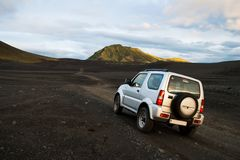 A 4x4 car in off-road route through the inland of Iceland through gravel and stone roads through spectacular landscapes stock photography