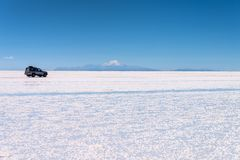 4x4 car in Salar de Uyuni Uyuni salt flats, Potosi Bolivia. 4x4 car in Salar de Uyuni Uyuni salt flats, Potosi, Bolivia royalty free stock photo