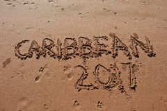 """Caribbean 2017"" written in the sand on the beach. Royalty Free Stock Images"