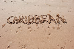 """Caribbean"" written in the sand on the beach. Stock Photography"