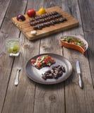 & x22; Churrasco de curacao& x22; , alimento brasileiro tradicional do assado imagens de stock