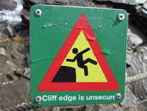 Cliff edge is unsecure warning sign royalty free stock photos