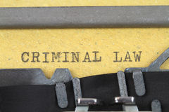 CRIMINAL LAW  written on a old typewriter. Retro conceptual image with CRIMINAL LAW text on a brown paper Royalty Free Stock Photo