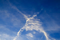 X cross cloud from  Aircraft Trails on blue sky background,Thail Royalty Free Stock Image