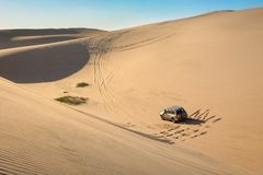 4x4 cruising on dunes in Namibia royalty free stock photography