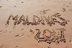 & x22; De Maldiven 2017& x22; geschreven in het zand op het strand Stock Fotografie