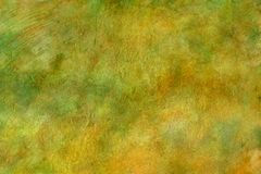 Spring Watercolor Texture / Fine Art Background. 6000 x 4000 @ 300 dpi jpeg file Beautiful shades amber and gold marbled with a green and a sprinkle of brown and Royalty Free Stock Image