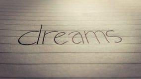 & x27; dreams& x27; geschreven op een stuk van document stock fotografie