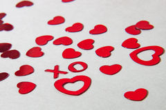 X e O vermelhos com corações Fotografia de Stock