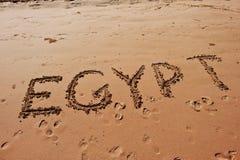 & x22; Egypt& x22;写在沙子在海滩 库存图片