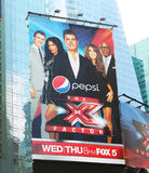 X Factor Billboard Advertising. Advertisement for the TV Show the X Factor on the Fox Channel. The judges are Simon Cowell, Paula Abdul, L.A. Reid, and Nicole Royalty Free Stock Photos