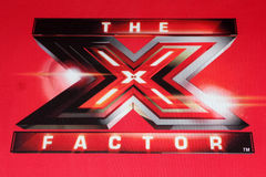 X Factor Logo at the FOX's. LOS ANGELES - DEC 19: X Factor Logo at the FOX's The X Factor Press Conference at CBS Studios on December 19, 2011 in Los Angeles, CA royalty free stock photo