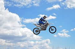 X games driver standing on the MX motorcycle is flying over the Stock Image