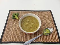 'Get better soon' written in vegetable soup with spoon. 'Get better soon' written on vegetable soup with spoon and vegetable next to it Royalty Free Stock Photo