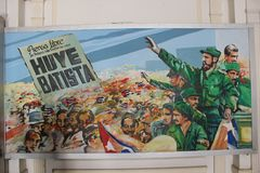 Huye Batista - a revolutionary poster from the Museum of Revolution in Havana, Cuba. The poster is located on the wall of the museum, along with many other Stock Photo