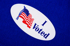 'I Voted' Sticker On Democrat Blue. Oval 'I Voted' sticker against a blue or Democratic colored background Royalty Free Stock Images