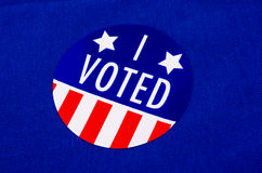 'I Voted' Sticker On Democrat Blue. Round 'I Voted' sticker against a blue or Democratic colored background Stock Images