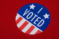 'I Voted' Sticker On Republican Red. Round 'I Voted' sticker against a red or Republican colored background Stock Image