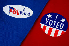 'I Voted' Stickers on Red And Blue. Two different kinds of 'I Voted' stickers on Democrat blue and Republican red. Divided America at election time Royalty Free Stock Photography