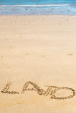 'Lato' word written on sand. 'Lato' word written on beach sand in sunny day Stock Photos