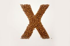 X letter. the alphabet of buckwheat. Porridge. buckwheat grain. concept of healthy eating. photo for your design. horizontal heet orientation royalty free stock photography