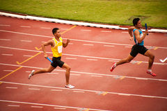 4x400m.Relay em Tailândia abrem o campeonato atlético 2013. Imagens de Stock