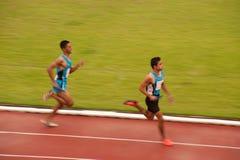 4x400m.Relay in Thailand Open Athletic Championship 2013. PHATUMTANI,THAILAND – SEPTEMBER,6 : Groups of men player  action of  4 x 400 Relay in Thailand Open Stock Image