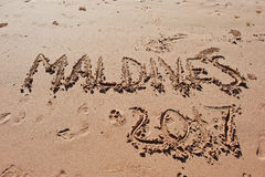 """Maldives 2017"" written in the sand on the beach. Stock Photography"