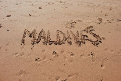 """Maldives"" written in the sand on the beach. Stock Images"