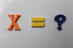 X mark equally question. Mathematics marks magnets on the white board Stock Photo