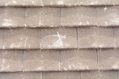 X mark on roof tiles to signify fixing point to wooden battens Stock Photos