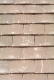 X mark on roof tiles to signify fixing point to wooden battens Stock Photo