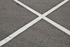 X marks the spot. Parking space lines corssing in a X shape Royalty Free Stock Image