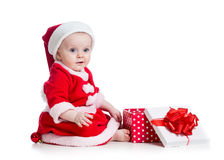 X-mas baby girl opening gift box Royalty Free Stock Photos