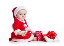 X-mas baby girl opening gift box Royalty Free Stock Photos