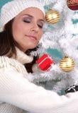 X-mas background. Peaceful christmas girl on x-mas tree stock photo