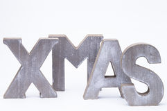 X-Mas. Capital letters forming the word xmas over white stock images
