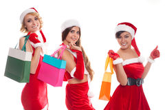 X-mas concept - smiling female in red costumes santa with colorf Royalty Free Stock Photography