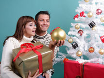 X-mas couple. Happy young winter xmas couple stock images