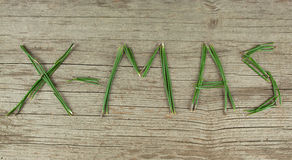 X-Mas Evergreen Sprigs on Rustic Wooden Board Stock Photography