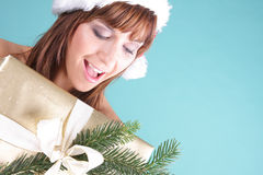 X-mas gift. Santa woman being happy with christmas gift stock image