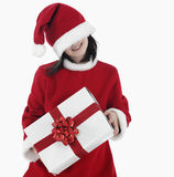 X-mas little girl with huge present Stock Photos
