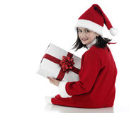 X-mas little girl with huge present Royalty Free Stock Image