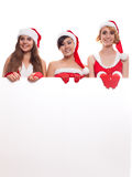 X-mas, people, advertisement and sale concept three happy wome royalty free stock photo