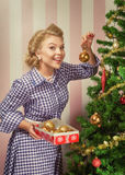 X-mas pinup. Portrait of nice young woman hanging around christmas tree on x-mas  eve Stock Images