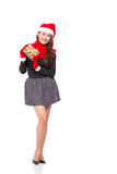 X-mas present. Full-length image of an attractive young woman with a x-mas present isolated on white Royalty Free Stock Photo