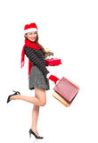X-mas shopping. Full-length portrait of an attractive lady having x-mas shopping against a white background Stock Image