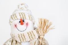 X-mas snowman. White with gold in a cap Stock Photos