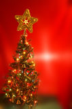 X mas tree. In red background Royalty Free Stock Images