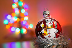 X-mas tree glass decoration with blurry background. X-mas tree glass decoration with background of blurry lights Royalty Free Stock Photos